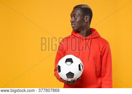 Handsome Young African American Man Guy Football Player In Red Streetwear Hoodie Isolated On Yellow