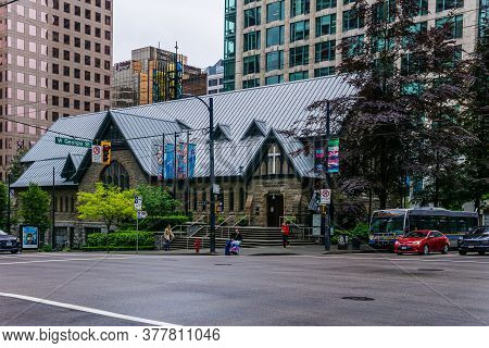 Vancouver, Canada - June 10, 2020: Street In Downtown Vancouver In Rainy Day With Buildings And Cars