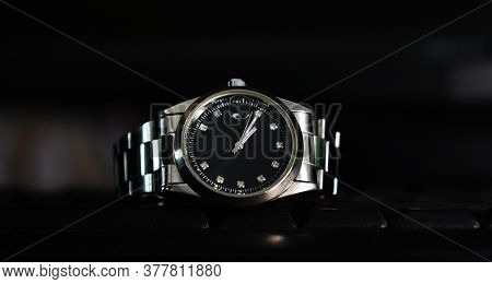 Silver Wristwatch With Black Dial In Black Color Background