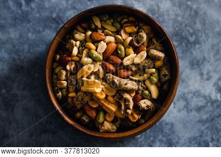 Healthy Plant-based Food Recipes Concept, Vegan Nuts And Legumes Snack Mix In Wooden Bowl