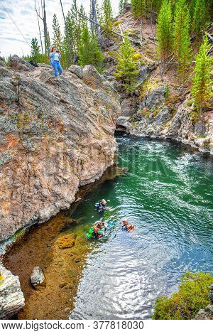 Wyoming, Usa - Aug. 24, 2019: Group Of Scuba Divers Explore Firehole River In Yellowstone National P