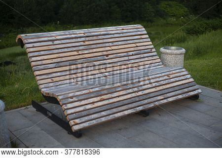 A Bench In The Park. A Place To Relax Outside. Wooden Bench In The City.