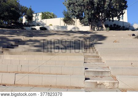 July 23, 2020 In Whittier, Ca:  Walkway Up Steps Besides Seating Where People People Watch Sports, C