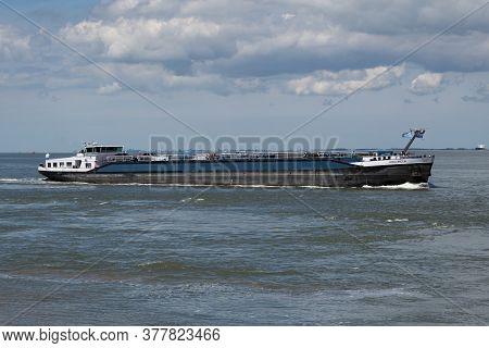 Terneuzen, The Netherlands, July 12, 2020, Motor Tanker Kralingen Inland Vessel On The Scheldt
