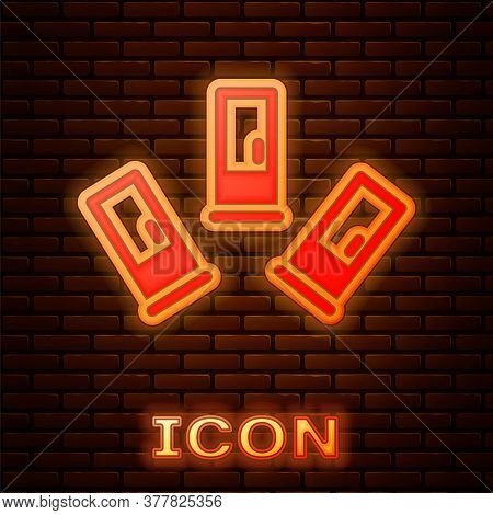 Glowing Neon Cartridges Icon Isolated On Brick Wall Background. Shotgun Hunting Firearms Cartridge.