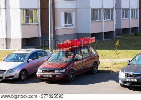 Gomel, Belarus - July 17 2020: Canoe On The Trunk Of A Rooftop Car During Summer Vacation. Road Trip
