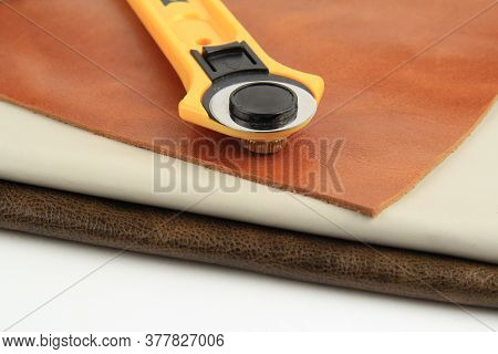 Brown Genuine Leather, White Fabric For Sewing Leather Products. A Tool For Sewing Leather. In The B