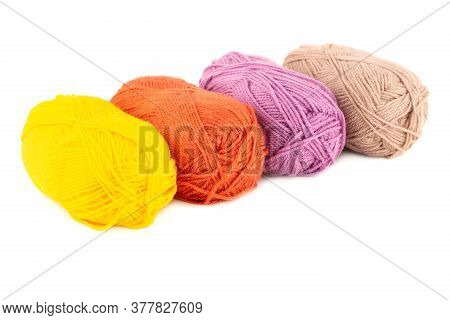 Four Knitting Yarn Clews Isolated On White Background.