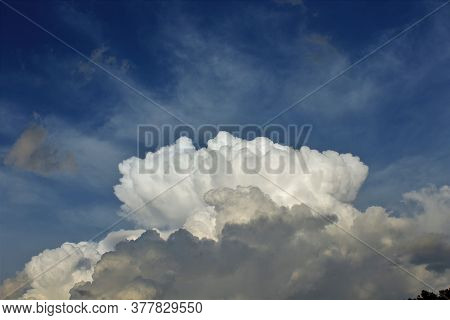 A Shot Of Cumulonimbus  Clouds On A Stormy Day With Blue Sky In The Back Ground. That's Bright And C