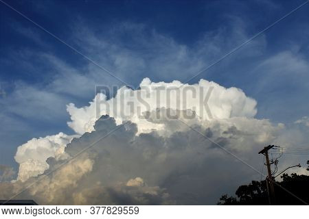 A Shot Of Cumulonimbus Clouds On A Stormy Night With Blue Sky In The Background. That's In Sterling