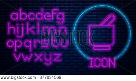 Glowing Neon Mortar And Pestle Icon Isolated On Brick Wall Background. Neon Light Alphabet. Vector
