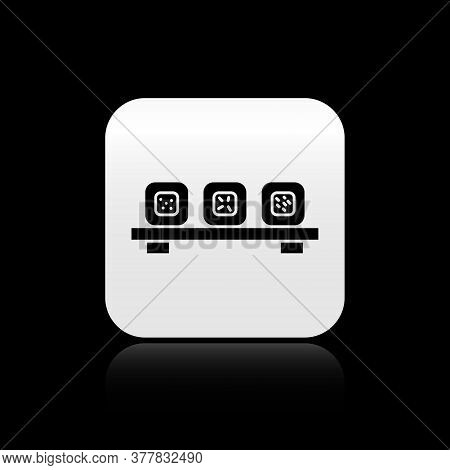 Black Sushi On Cutting Board Icon Isolated On Black Background. Asian Food Sushi On Wooden Board. Si