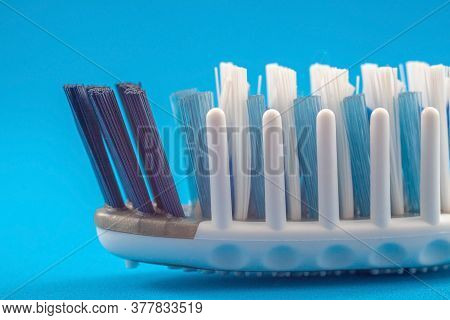 Toothbrush Head With Massage Bristles Close-up On A Blue Background. Caring For Healthy Teeth And Gu