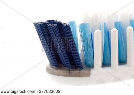 Toothbrush Head With Massage Bristles Close-up On A White Background. Selective Focus. Caring For He