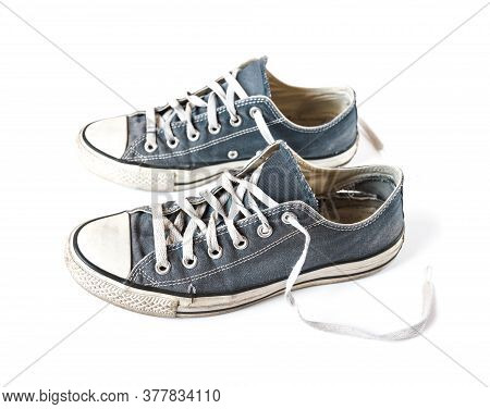 Old Blue Generic Sneakers Isolated On White Background
