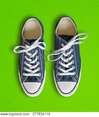Blue Generic Sneakers Isolated On Green Background