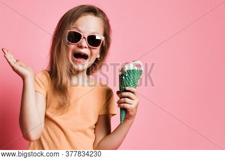 Frolic Kid Girl Preschooler In T-shirt And Sunglasses With Big Vanilla Ice Cream With Candies In Waf