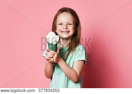 Portrait Of Frolic Pretty Kid Girl In T-shirt Holding Going To Eat Showing Big Vanilla Ice Cream In
