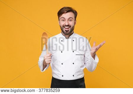 Excited Young Bearded Male Chef Cook Or Baker Man In White Uniform Shirt Posing Isolated On Yellow B