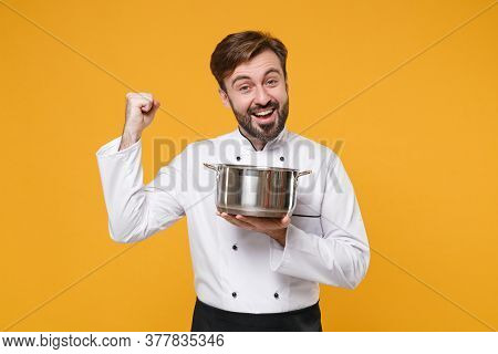 Joyful Young Bearded Male Chef Cook Or Baker Man In White Uniform Shirt Posing Isolated On Yellow Ba