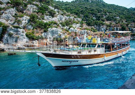 Tourist Boat In Mediterranean Sea. Excursion Along Shores Of Ancient Sunken Lycian Underwater City O
