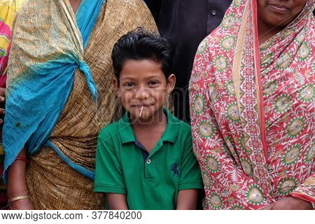 KUMROKHALI, INDIA - FEBRUARY 24, 2020: Portrait of a boy in Kumrokhali village, West Bengal, India
