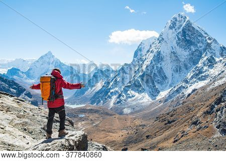 Trekker Standing At The Edge Of The Mountain Cliff And Looking To The Beautiful View Of Mt.ama Dabla