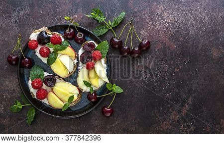 Sweet Toasts For Healthy Breakfast With Ricotta, Fresh Peach, And Berries. Copy Space, Top View.