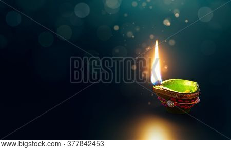 Happy Diwali, Glittering Diya Oil Lamp On Dark Background With Copy Space
