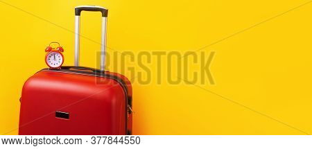 Travel Case With Alarm Clock  Over Yellow Background. Time To Voyage. Voyage Concept. Retro Alarm Cl