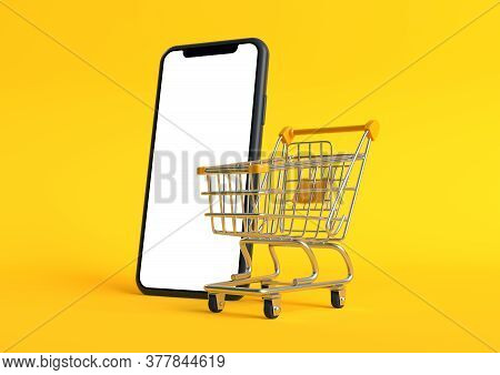 Shopping Cart With Empty Smartphone Screen On A Yellow Background. Shopping Trolley. Grocery Push Ca