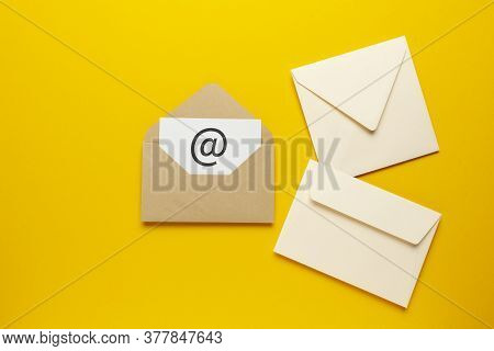 Envelope With E-mail Symbol On Yellow Background, Concept Of Corporate Communication And Marketing M