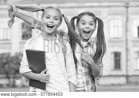 Who Says Growing Hair Cant Be Fun. Happy Girls With Long Healthy Hair. Beauty Look Of School Childre