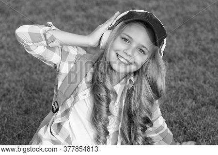 Pleasant Time. Child Headphones Listen Music. Girl Headphones Listening Music. Educational Podcast.