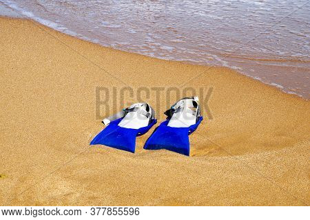 Flippers On The Sand Against The Background Of The Sea, Copy Space