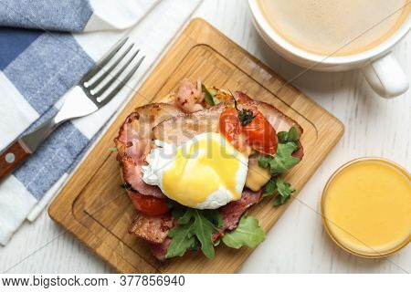 Delicious Egg Benedict Served On White Wooden Table, Flat Lay