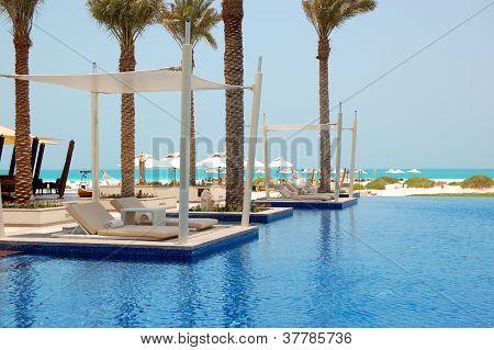 Swimming Pool Near Beach At The Luxury Hotel, Saadiyat Island, Abu Dhabi, Uae