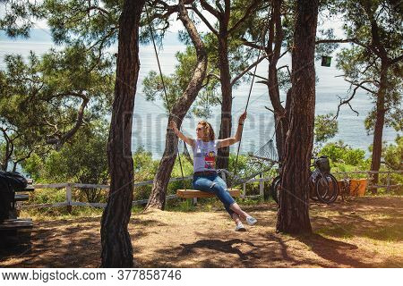 Istanbul, Turkey: Beautiful Girl Swinging On A Swing In Heybeliada Island Located In Marmara Sea Not