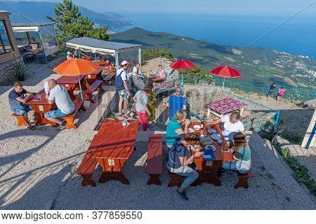 Ai-petri, Crimea - July 5, 2019. Tourists In A Cafe On The Top Of The Mountain