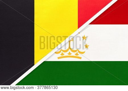 Belgium And Tajikistan, Symbol Of Two National Flags From Textile. Relationship, Partnership And Cha