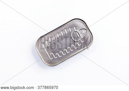 Canned Fish In Sealed Oval Tin Can With Easy Openable Lid On A White Background - Top View