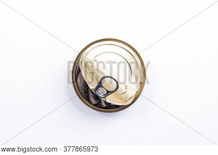 Smoked Sprats In Cooking Oil In The Open Tin Can Isolated On White Background - Top View