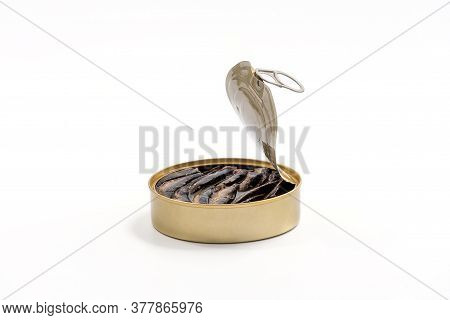 Smoked Sprats In Cooking Oil In The Open Tin Can Isolated On White Background