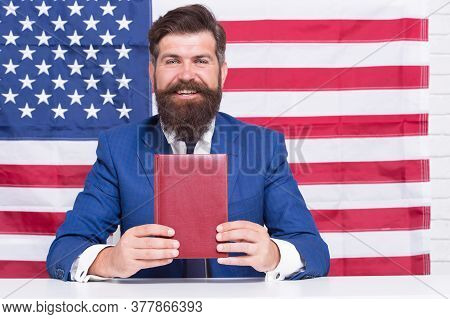 Lead With Language. English Language Learner. Happy Hipster Hold Book On American Flag Background. L