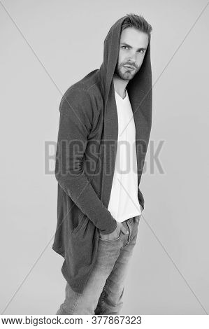 Fashion Design Gives Sporty Feel. Fashion Man Yellow Background. Handsome Guy Wear Hooded Sweatshirt