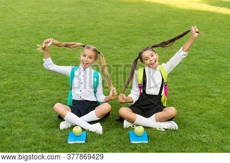 Because We Obsess About Hair. Happy Girls Hold Long Hair. Hair Salon. Beauty Look Of Small Children.