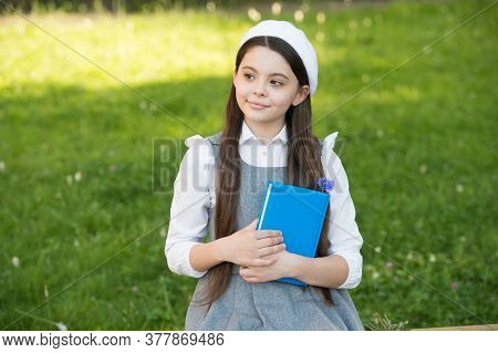 Be Mindful. Thoughtful Child Think Sitting On Bench Outdoors. Little Girl Back To School. Learning A