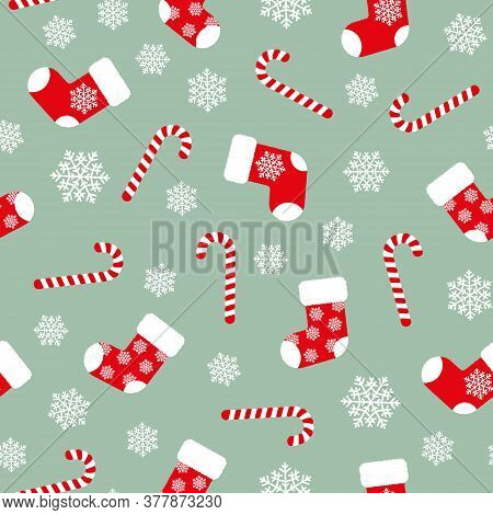 Red Fluffy Christmas Stockings, Candy Canes And White Snowflakes On Green Background Seamless Patter