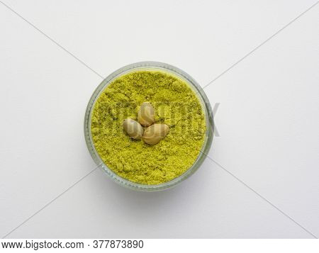 Pistachio Flour In A Glass Bowl On A White Background. Shredded Pistachios.