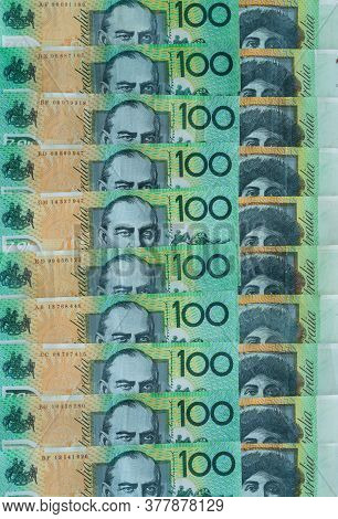 Several Australian $100 Notes Lined Up To Make Money Background